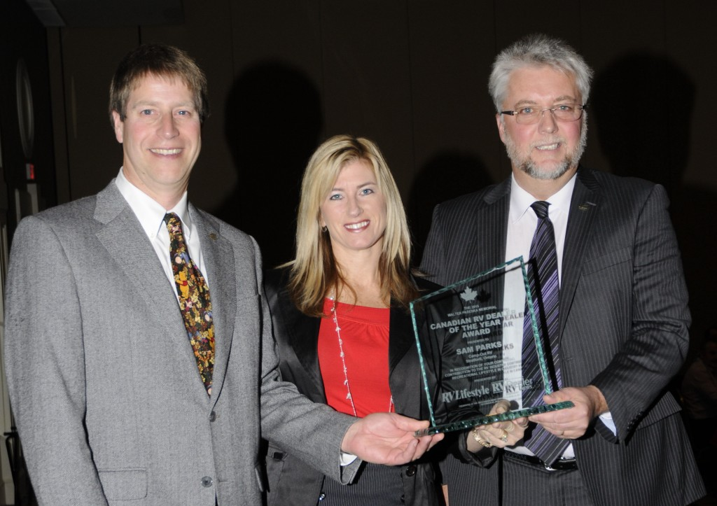 L-R: Ian Moore, the 2013 Canadian RV Dealer of the Year, and Melanie Taylor, Associate Publisher of RV Lifestyle Magazine, present the 2015 Canadian RV Dealer of the Year Award to Sam Parks, Camp-Out RV, Stratford Ontario, at the RVDA of Canada Award Diner in Louisville, KY, Monday November 30, 2015.